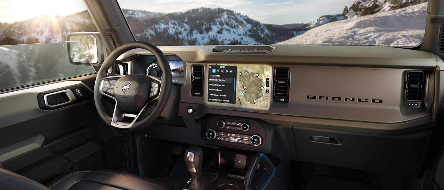 Interior IP of the Ford Bronco with mountain landscape through windows