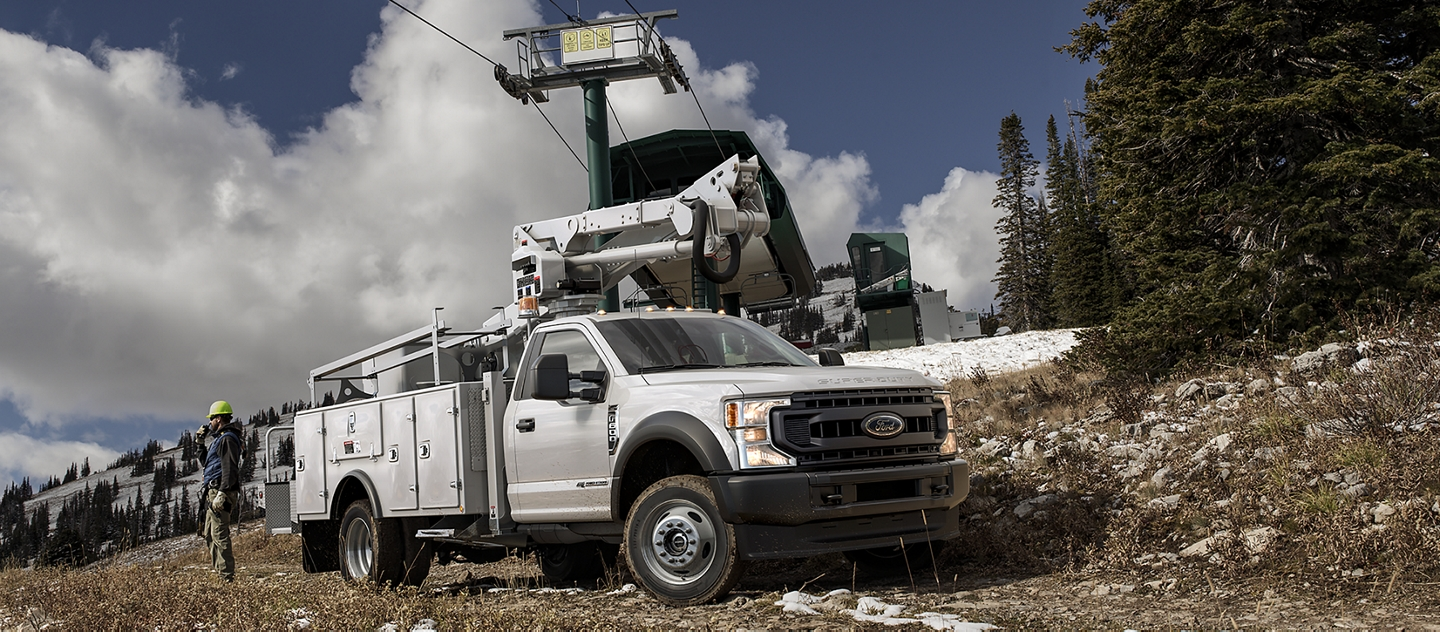 2020 Ford Super Duty X L Chassis Cab in Oxford White  with upfit under cable cars on slightly snowy mountain