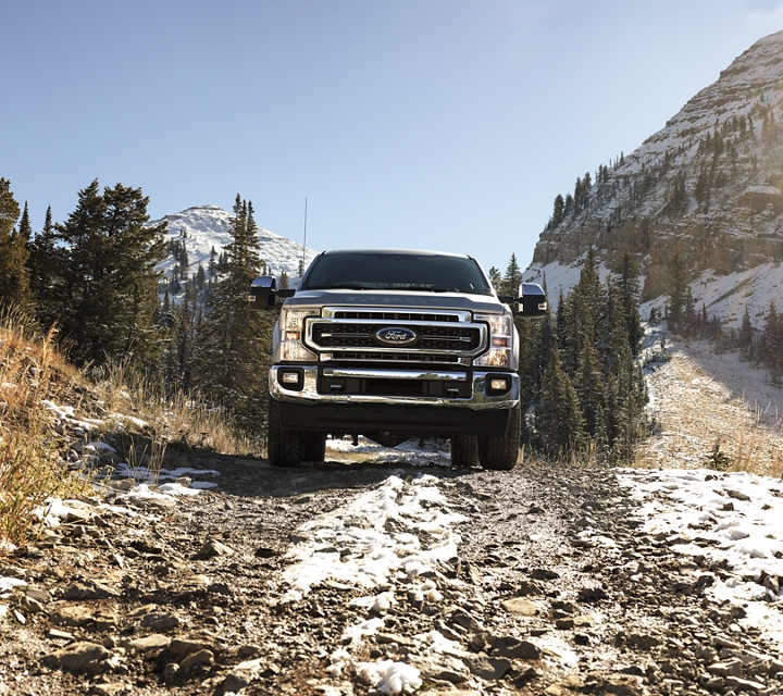 2020 Ford Super Duty Chassis Cab LARIAT driving up snowy mountains