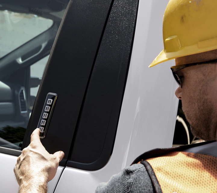 Man using Securicode Keyless Entry Pad on side of 2020 Ford Super Duty Chassis Cab in Oxford White