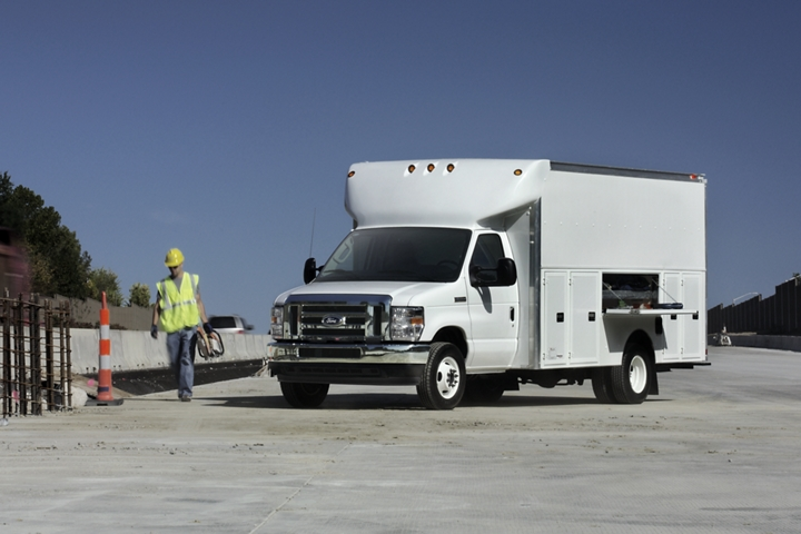 A 2021 Ford E Series Dual rear wheel cutaway with delivery and utility upfit plus High Series Exterior Upgrade Package