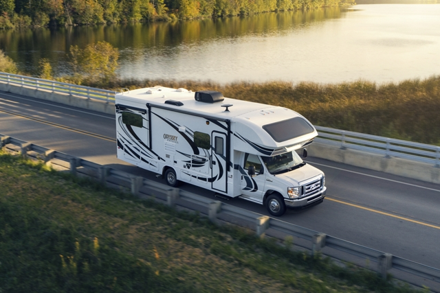 The 2021 Ford E Series with Class C Motorhome towing auto trailer