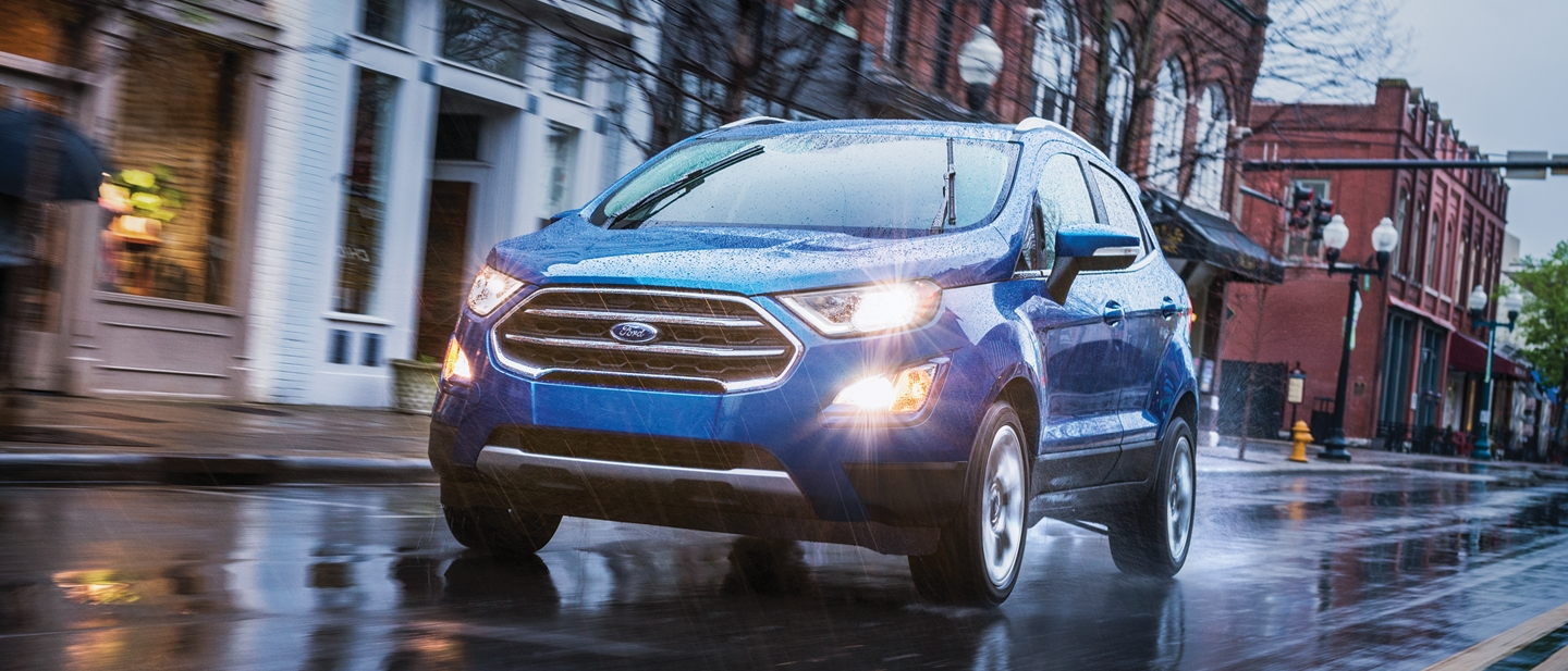 2019 Ford EcoSport in Lightning Blue being driven on a wet road