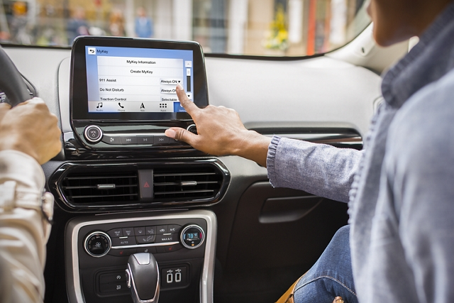 In the 2019 Ford EcoSport a passenger is programming MyKey to help younger drivers build responsible habits
