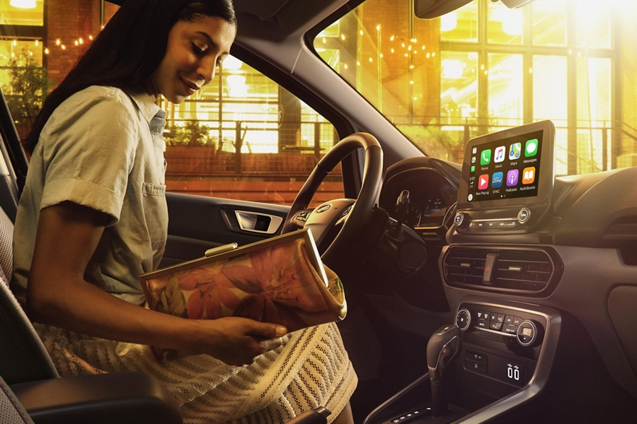 2019 Ford EcoSport interior with a woman in the drivers seat