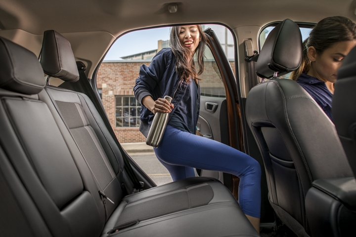 Woman getting into roomy rear seat of the 2019 EcoSport