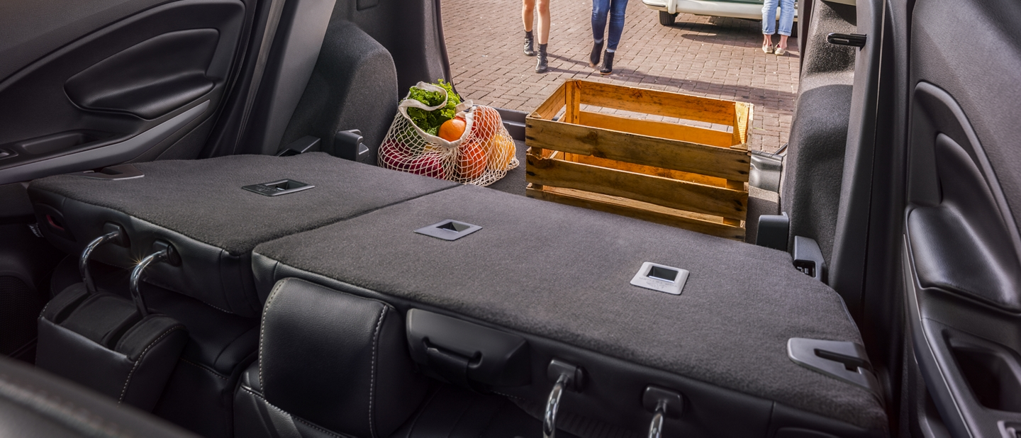2019 EcoSport rear cargo area with seats folded down and cargo packed in