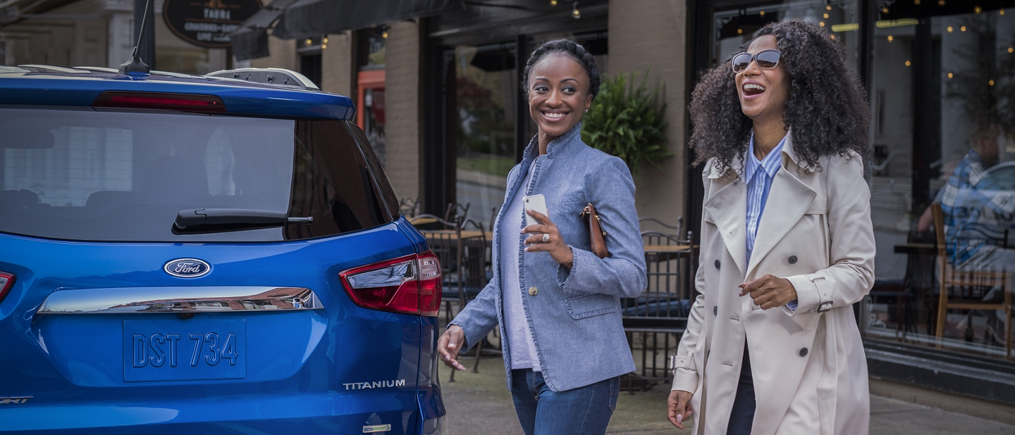 Women walking toward a 2019 EcoSport after a fun night out