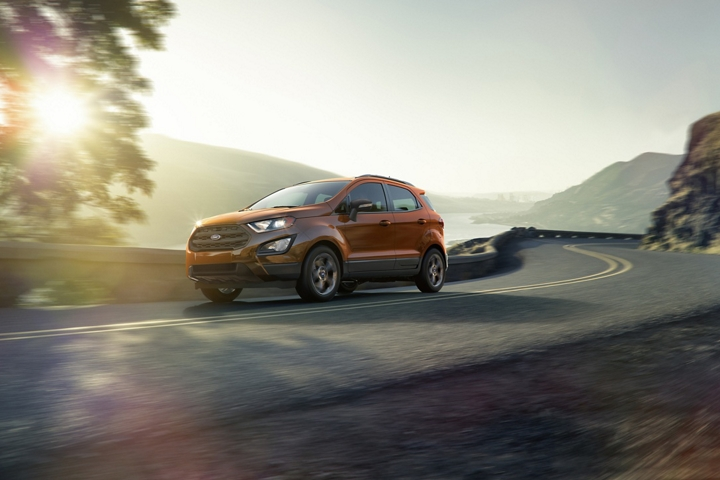 2020 Ford EcoSport S E S in Canyon Ridge on a winding road