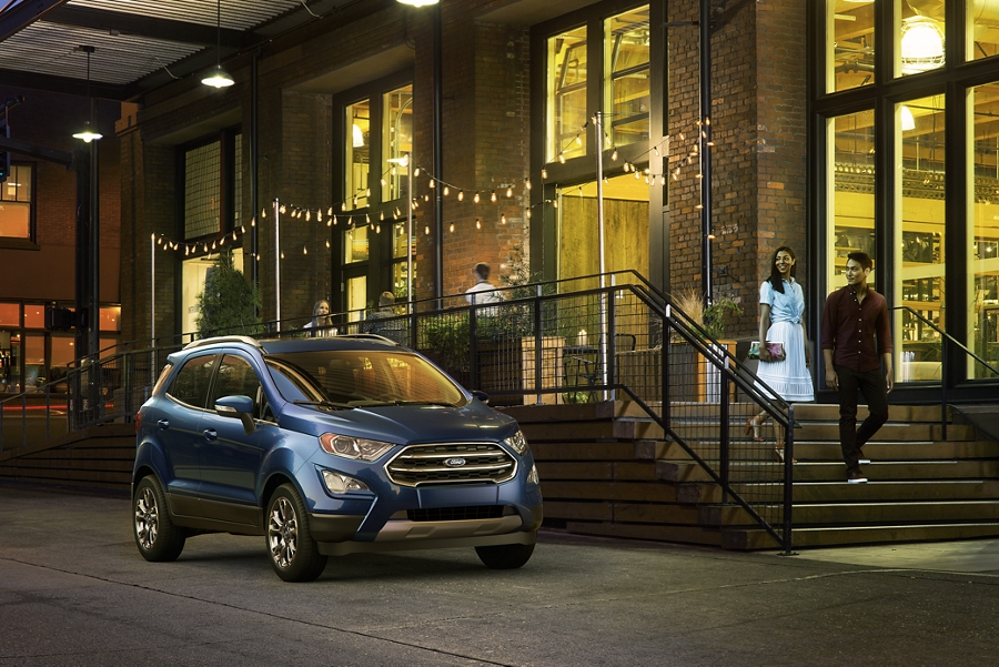 A couple walks toward a 2020 Ford EcoSport at night