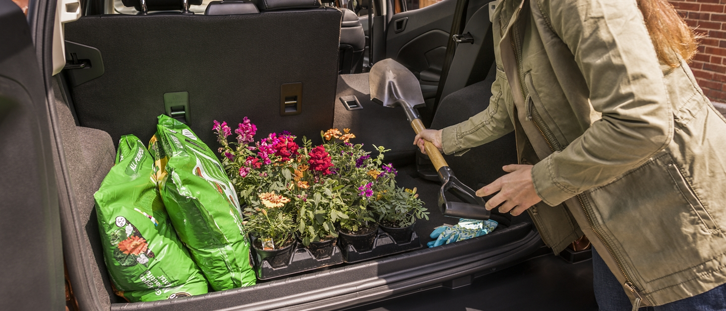 2020 Ford EcoSport rear cargo area with seats folded down and gardening supplies packed inside