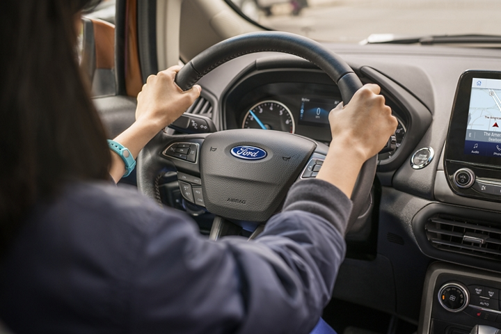 A woman behind the wheel of a 2020 Ford EcoSport