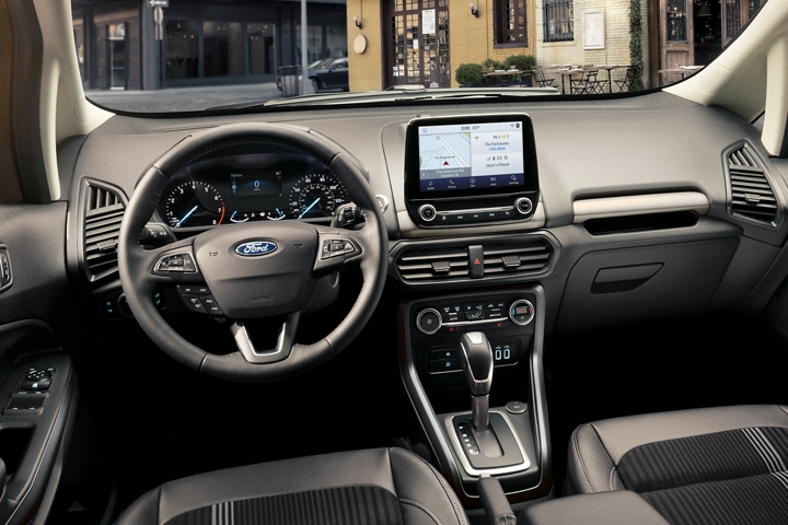 2020 Ford EcoSport interior showing instrumentation leather wrapped gear shift knob and available 8 inch touchscreen
