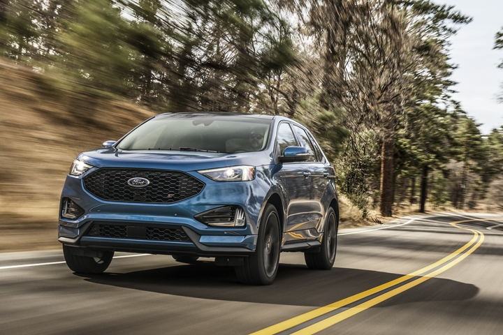 2020 Ford Edge S T Shown in Ford Performance Blue being driven in the woods