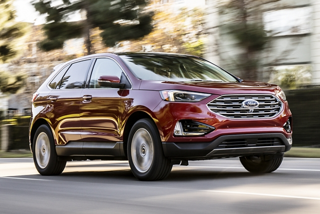 2020 Ford Edge being driven down the road with trees in the background