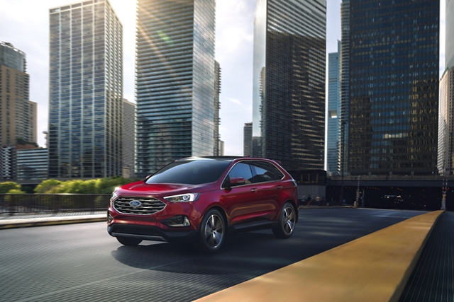 2020 Ford Edge Titanium shown in Rapid Red Metallic Tinted Clearcoat on a bridge