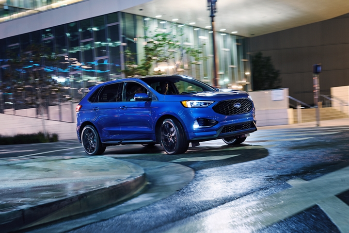2020 Ford Edge S T Shown in Ford Performance Blue turning a corner