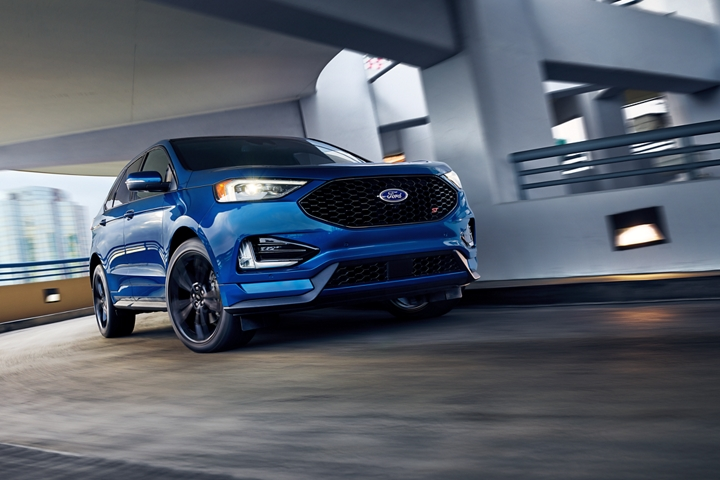 2020 Ford Edge S T shown in Ford Performance Blue making a tight turn