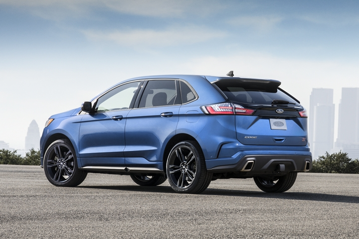 2020 Ford Edge S T Shown in Ford Performance Blue outside the city