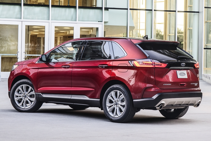 2020 Ford Edge Titanium Shown in Rapid Red Metallic Tinted Clearcoat in front of glass building