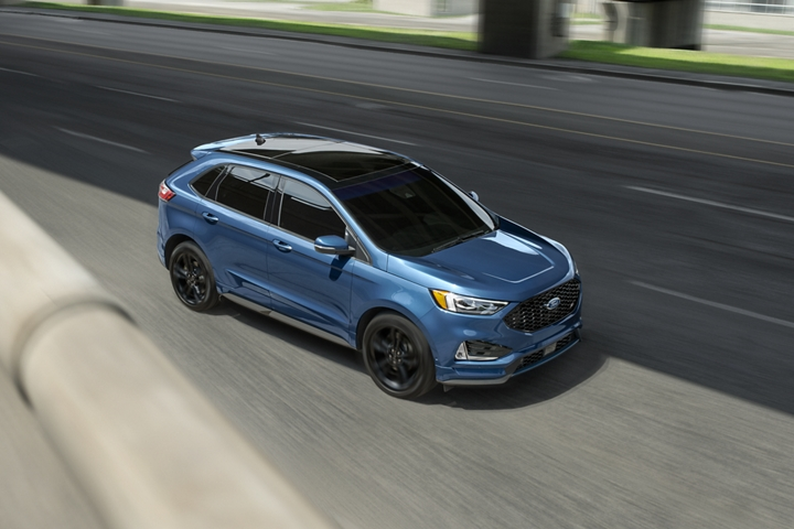 2020 Ford Edge S T shown in Ford Performance Blue shifting lanes