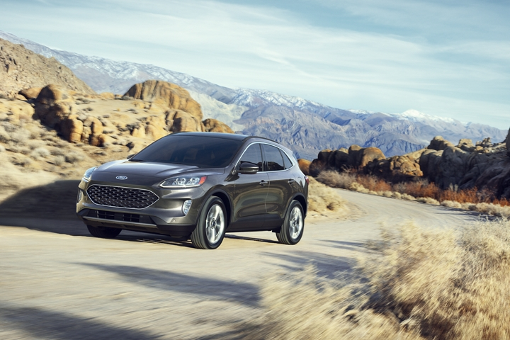 2020 Ford Escape in Magnetic being driven on a mountain road
