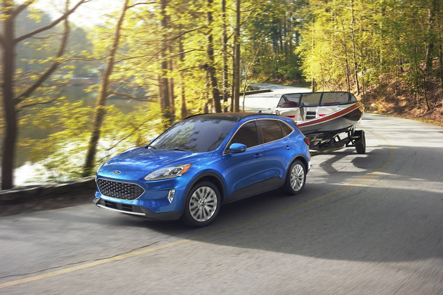 2020 Ford Escape towing a boat on a winding road