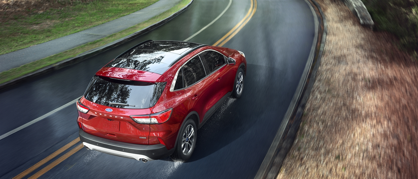 2020 Ford Escape S E L driving down winding road