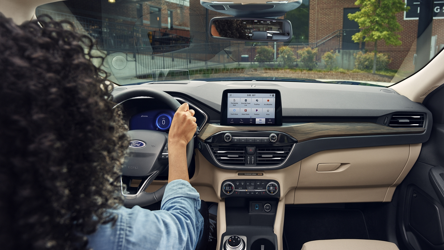 Interior view of woman behind the wheel of a 2020 Ford Escape