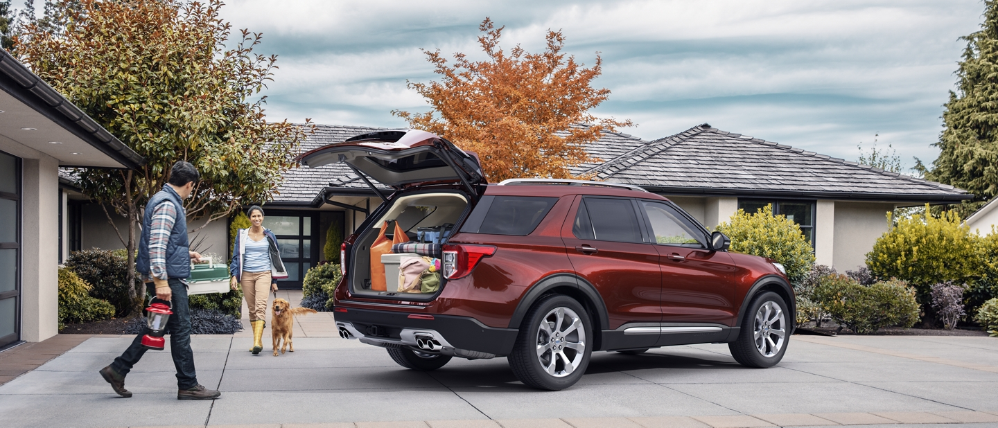 A 2020 Ford Explorer in Rich Copper parked in the driveway of a home