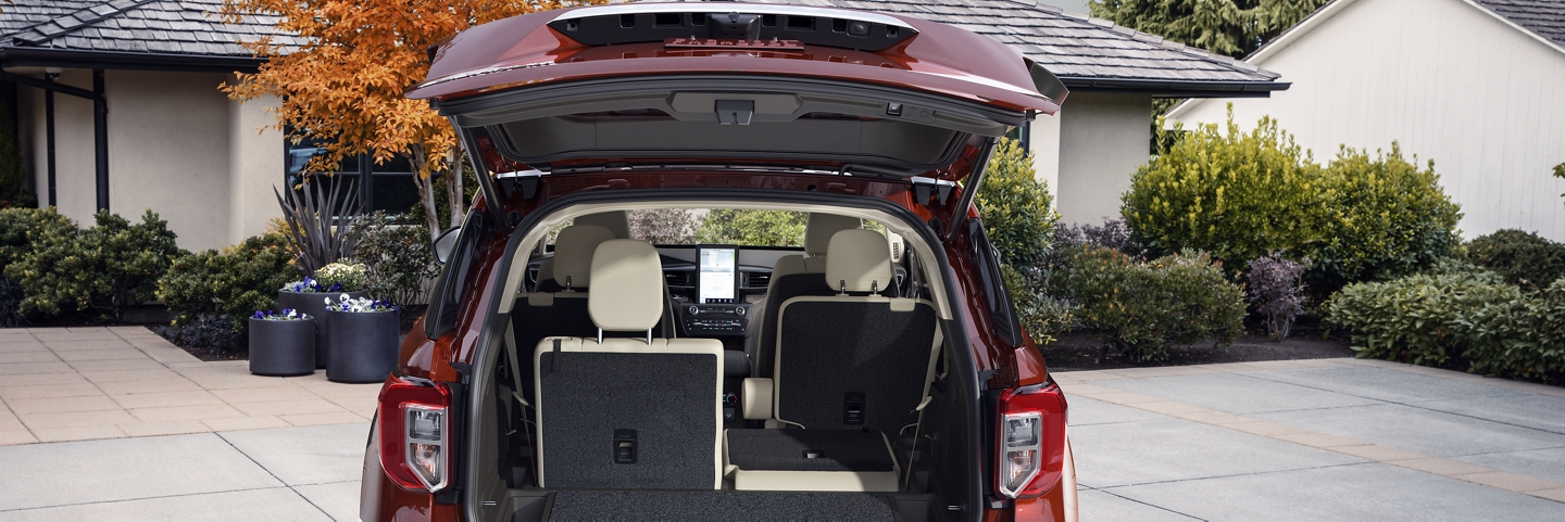 Explorer Platinum in Rich Copper shown with the liftgate open and the fifty fifty fold flat seats folded down