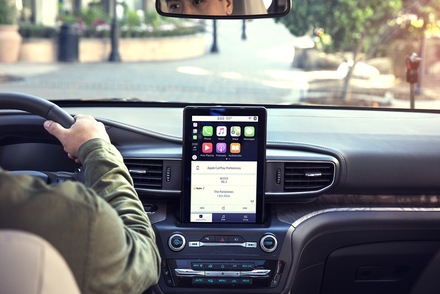 A close up view of a 2020 Ford Explorer dashboard featuring a portrait touchscreen in the centre stack