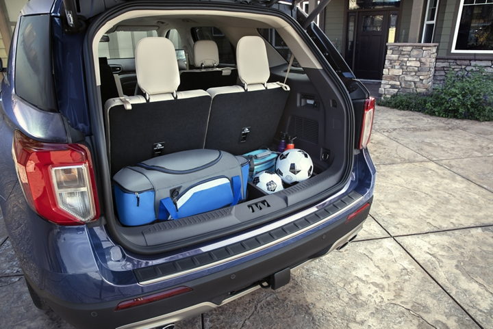 The open cargo space of a 2020 Explorer carrying a cooler and soccer equipment