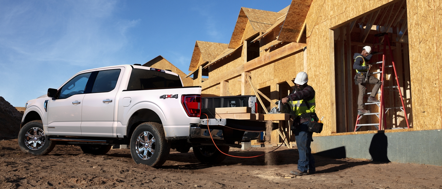 A construction worker using pro power on board from a 2021 Ford f one fifty