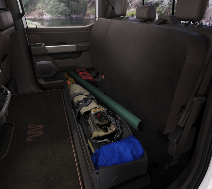 2021 Ford F one fifty interior with the back seats folded up to make space for camping gear