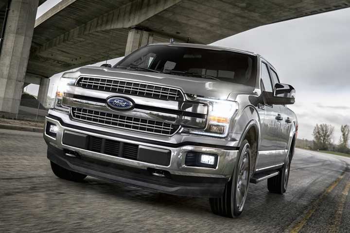 2020 Ford F 1 50 travelling on rural road under bridge