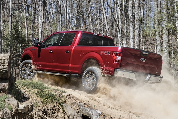 2020 Ford F 1 50 X L T with X T R Package being driven uphill on dirt road