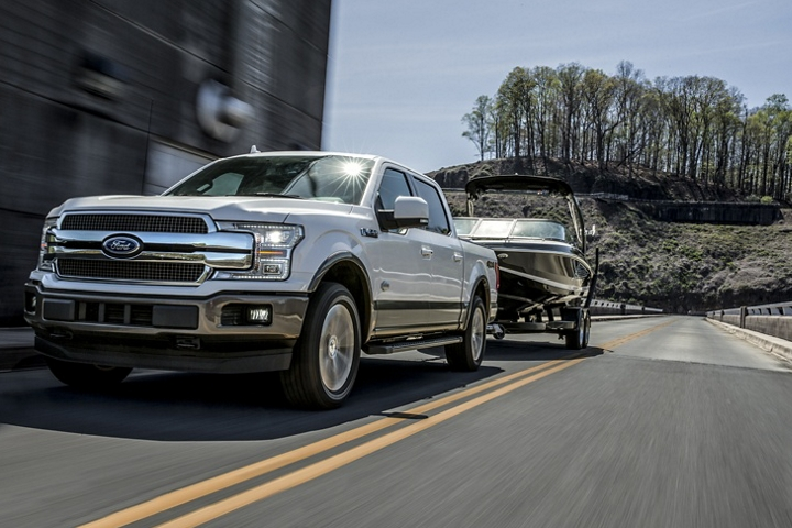 2020 Ford F 1 50 King Ranch towing a boat