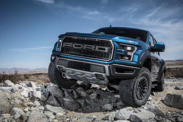 2020 Ford F 1 50 Raptor climbing over rocky terrain