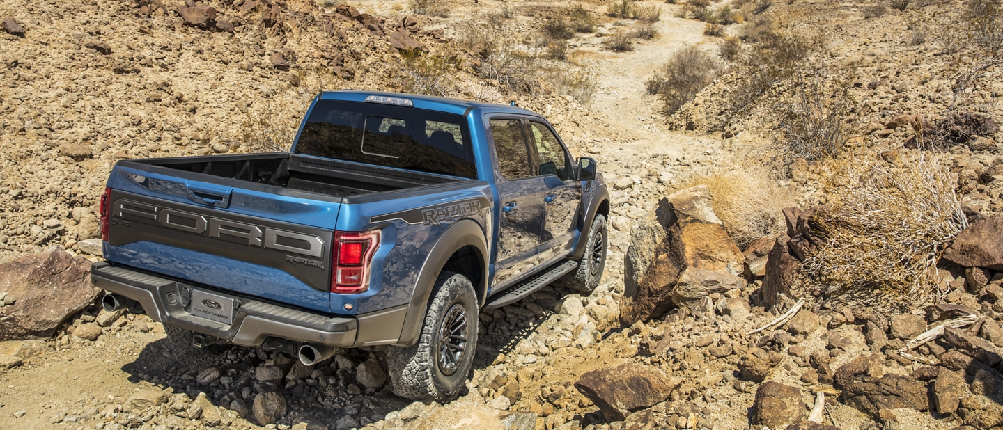 2020 Ford F 1 50 Raptor travelling on steep off road incline