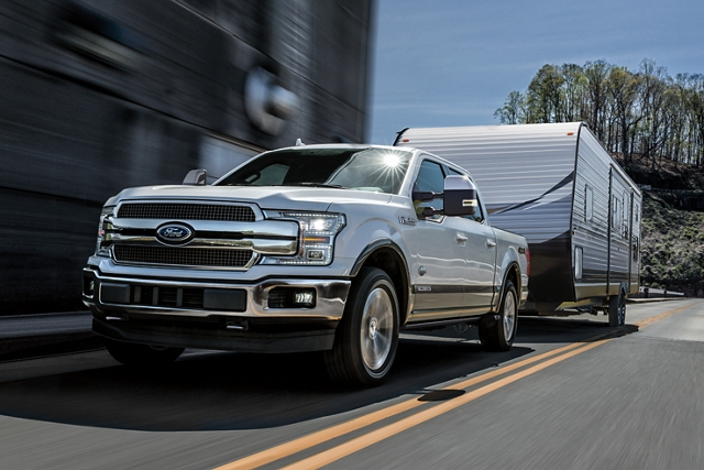 2020 Ford F 1 50 pulling camper down the road