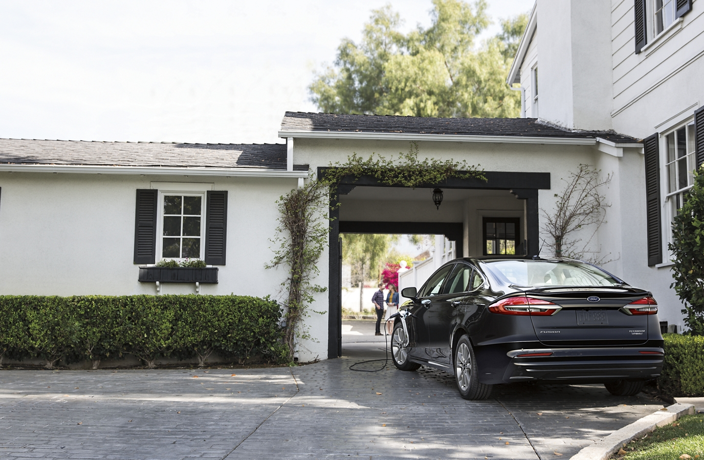 2020 Ford Fusion Titanium Plug in Hybrid being charged in a driveway