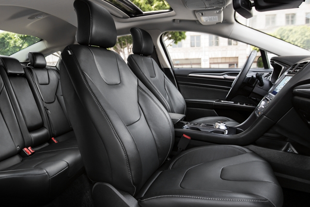 2020 Ford Fusion black interior with a leather wrapped steering wheel
