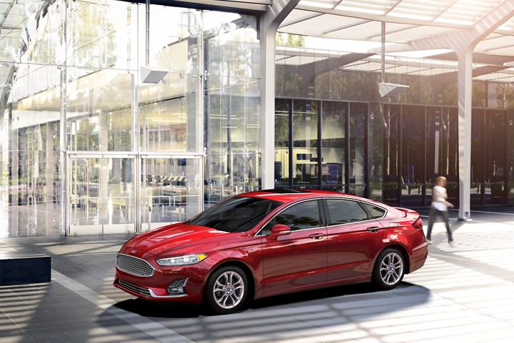 2020 Ford Fusion in Rapid Red parked in a large atrium