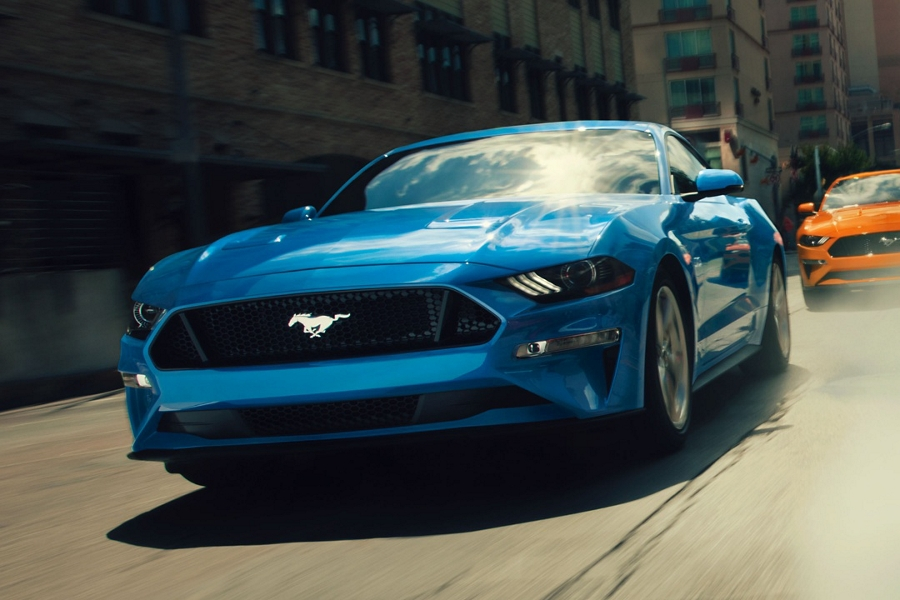 2020 Ford Mustang in Blue followed by a 2020 Ford Mustang in Twister Orange