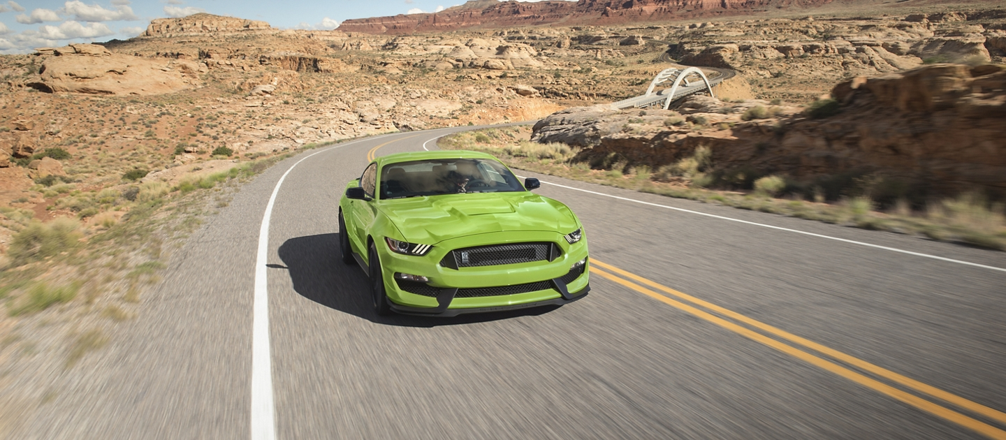 2020 Ford Mustang being driven down a desert road