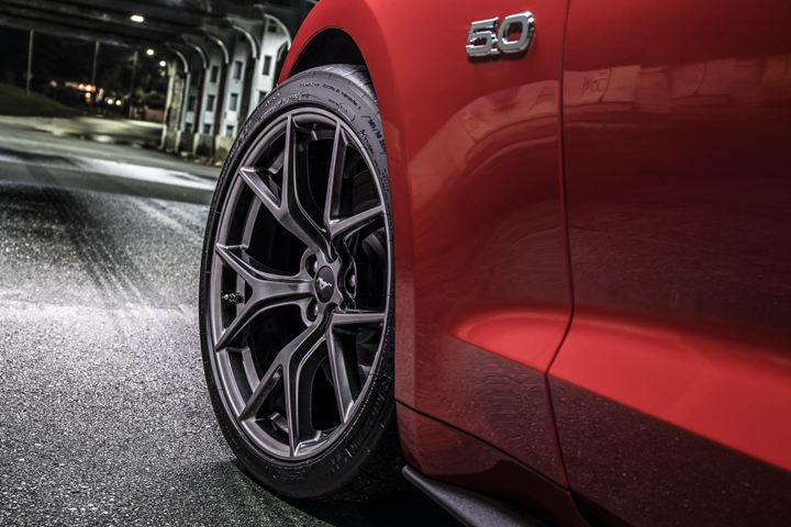 2020 Ford Mustang G T in Rapid Red going through a tunnel