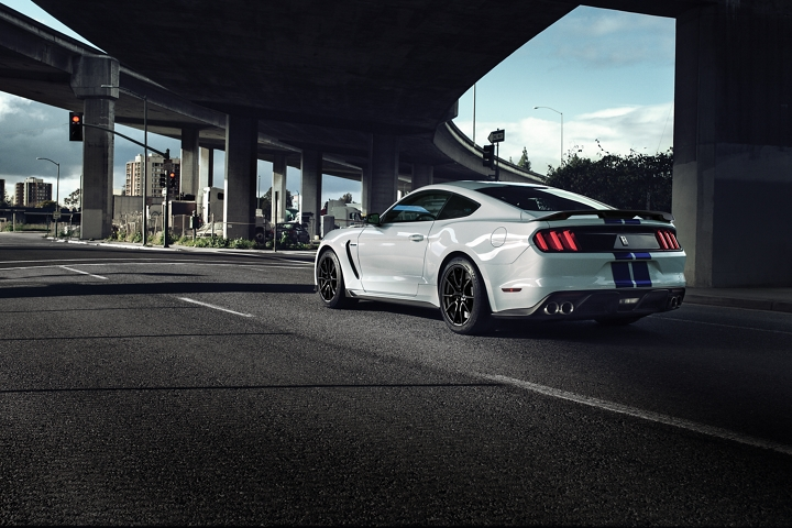2020 Ford Mustang Shelby G T 3 50 shown from the rear while driving under a freeway overpass