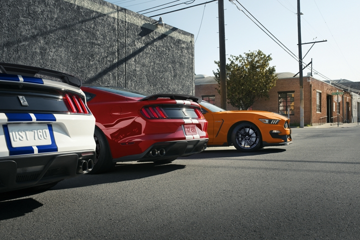 A lineup of three 2020 Ford Mustang G T three fifties parked in a lot