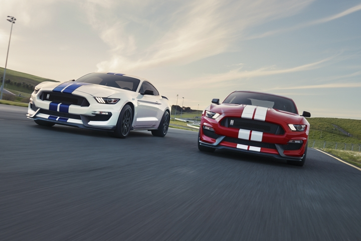 A pair of 2020 Ford Mustang Shelby G T three fifties on a race track